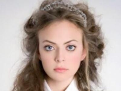 女生全头烫发发型 瘦脸减龄展现动态美