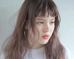 今年流行蓬松卷烫发 头发越烫越美变女神